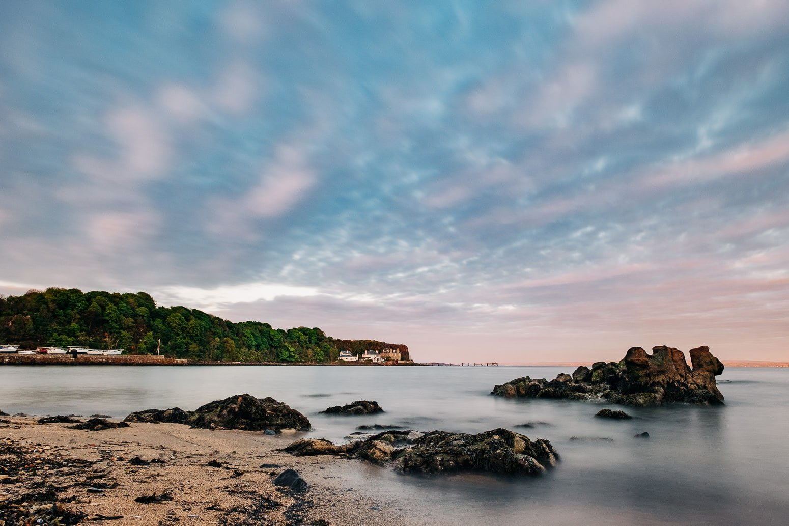 Long exposure of Aberdour Black Sands Beach at sunset