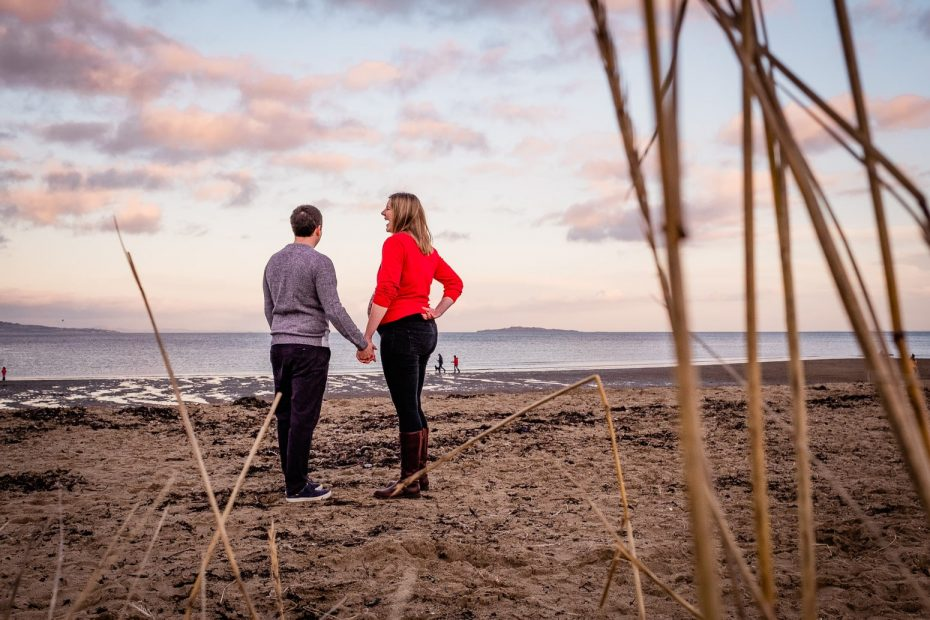 Pregnant couple enjoying the sunset on Cramond Beach
